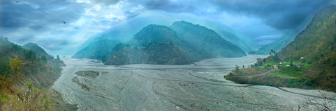 Wide river with mountain ranges. India, Uttarakhand Stock Photography