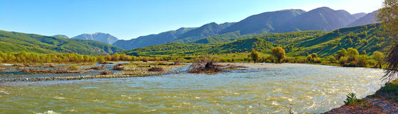 The wide river in mountains Stock Photo