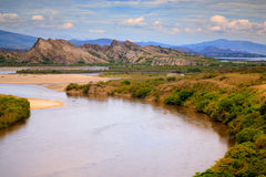 Wide river and rock mountains Royalty Free Stock Image