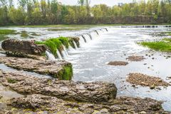 Wide river with waterfall