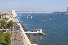 Wide river with yachts and modern bridge Stock Photo
