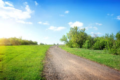 Wide road in the field Royalty Free Stock Photo