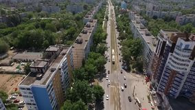Wide road with tram line in modern city, aerial shot stock video