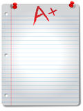 Wide Ruled Notebook Paper Pages Tacks & Grade. Page of wide ruled notebook paper, red tacks and A+ grade,  highlighted by a spotlight, with a drop shadow Royalty Free Stock Photo