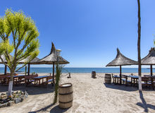 Wide sand beach with umbrellas on Black Sea Stock Images