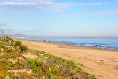 Wide sandy beach in Costa Blanca, Valencia region, Spain. Stock Image