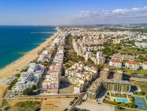 Wide sandy beach in touristic Quarteira and Vilamoura, Algarve,. Wide sandy beach in touristic resorts of Quarteira and Vilamoura, Algarve, Portugal Royalty Free Stock Images