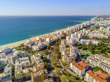 Wide sandy beach in touristic Quarteira and Vilamoura, Algarve,. Wide sandy beach in touristic resorts of Quarteira and Vilamoura, Algarve, Portugal Stock Photography