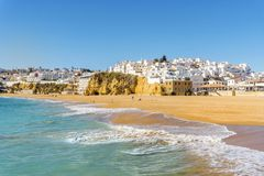 Wide, sandy beach in white city of Albufeira, Algarve, Portugal. Wide, sandy beach in white city of Albufeira by Atlantic Ocean, Algarve, Portugal royalty free stock photos