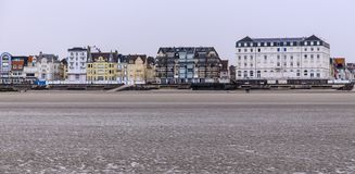 Beach at low tide at cote d`opale on the north french coast. The wide sandy beach of Wimereux on the French north coast royalty free stock image