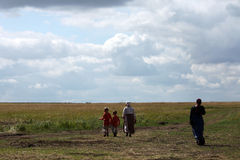A wide scale. Women and children walking in the field at large Royalty Free Stock Photos