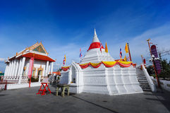 Wide scene White stupa pagoda with red robe blue sky background Stock Photo