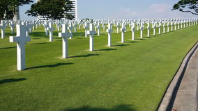 Wide Scenery From Graves Manila, Philippines. American Cemetery, rows of white crosses, wide shot still stock video