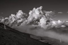 A Wide Scenic View to the Ropeway with Giant Clouds on Background. Monochrome picture Royalty Free Stock Photos