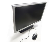 Wide Screen LCD Computer Monitor and Mouse Royalty Free Stock Photos