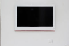 Wide screen TV on the wall Royalty Free Stock Image
