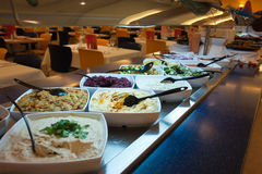 Wide selection of fresh salads at a buffet bar Stock Images