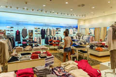 Wide Selection Of Woman Clothes In Shopping Mall Royalty Free Stock Photo