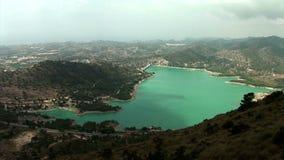 Wide shoot from above of water reservoir `Embalse de Amadorio` in Orxeta, Spain. stock footage