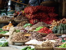 Wide shot of Asian wicker baskets full of roots, garlic, fruit, vegetables and hot red peppers Stock Images
