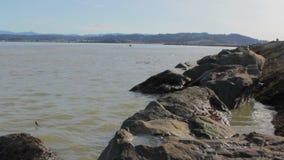 Wide Shot Bay Harbor Rocks Ocean Waves stock video footage