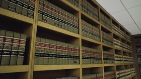 Wide shot of books in legal library in law firm stock video footage