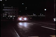 Wide shot cars driving on city road at night stock video