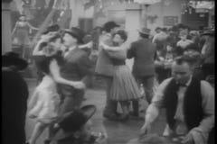 Wide shot couples dancing in bar