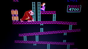 Wide shot 'Donkey Kong' retro arcade vintage videogame during game play from
