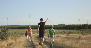 Family moving on pathway in field