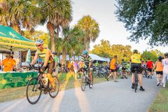 Wide shot of festivities area with bikers riding through, editorial. royalty free stock photo