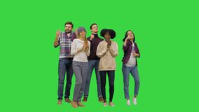 Thumbs up Great job, people congratulating someone behind the camera with a complete success on a Green Screen, Chroma