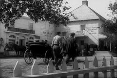 Wide shot horse and buggy riding through town stock video