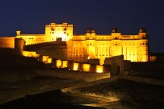Wide shot of Jaigarh Fort in India with lights at night time
