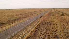 A long road and the land`s horizon. A wide shot of a long road and the land`s horizon in slow motion. Camera moves forward stock footage