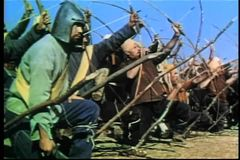 Wide shot medieval bow and arrow warfare on battlefield stock footage