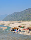 Pilgrims at river bank Stock Images