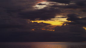 Ocean and dusk sky shot. A wide shot of the ocean and dusk sky. Shot tilts up to show the sky stock video footage
