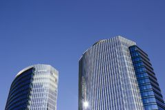 Wide shot of a pair of twins corporate blue office high-rise buildings with a striped design. Both of them with a two different glass window walls. San Pedro royalty free stock images