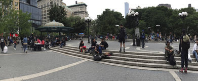 Wide shot of People along Union Square and 14th street NYC Stock Images