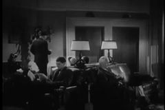 Wide shot of people waiting in lobby of hotel, 1940s stock footage