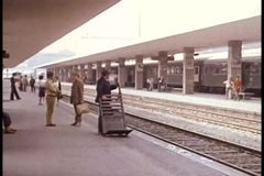 Wide shot of people waiting on train platform stock video footage