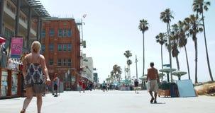 People Walking on Venice Beach Boardwalk, Los Angeles California stock video footage