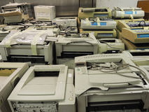 Wide shot of pile or stack of old printers that are out of date. Royalty Free Stock Photo
