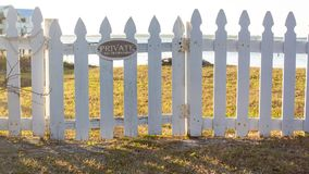 Wide shot - Private No Trespassing sign on picket fence Royalty Free Stock Images