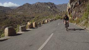 Downhill road cycling stock video footage