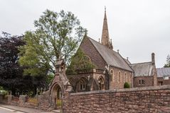 Wide shot of Saint Andrews Church, Fort William Scotland. Fort William, Scotland - June 11, 2012: Wide shot of brown-stone Saint Andrews Church with spire under royalty free stock photos