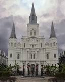 Wide shot of Saint louis Cathedral in New Orleans. Saint louis Cathedral in French Quarter of New Orleans, Louisiana with cloudy sky Stock Photos