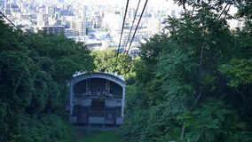 Wide shot of sapporro city from a cable car going up mountain moiwa, hokkaido, japan stock video