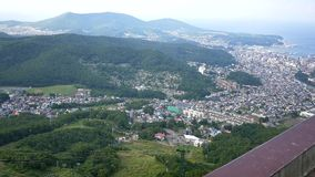 Wide shot of sapporro city from the top of mountain moiwa, hokkaido,japan stock footage